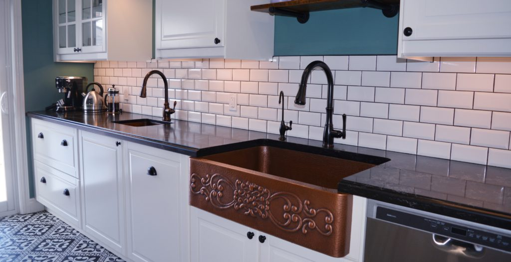 2 copper sinks with bronze faucets really bring the Victorian feel to life!