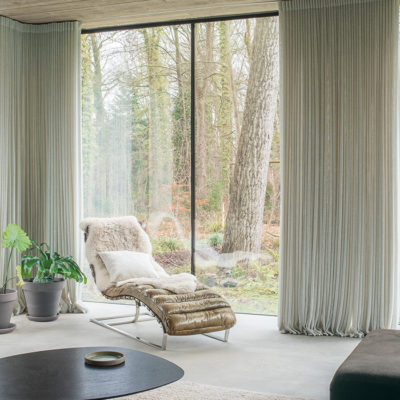 chair by window, patio door, nature outside, cozy nook, pretty drapes
